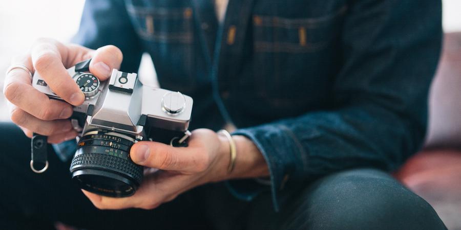 Man-holding-camera