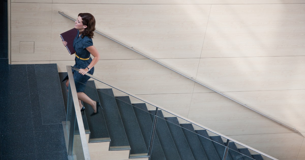 Businesswoman_ascending_staircase