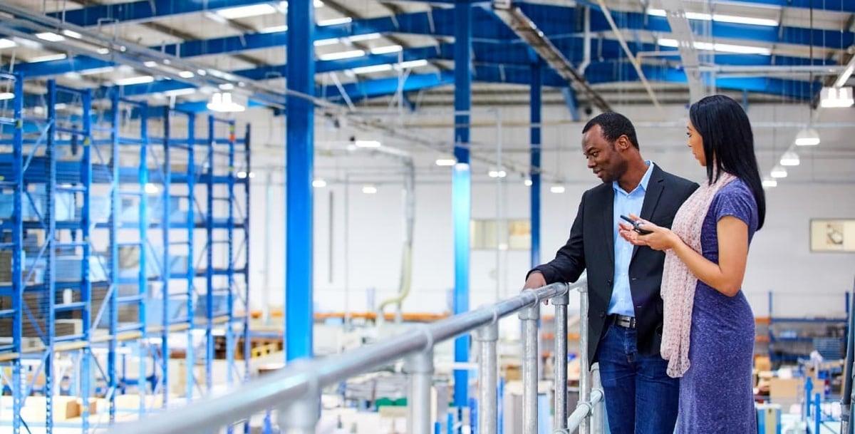 industrial sales meeting on plant floor