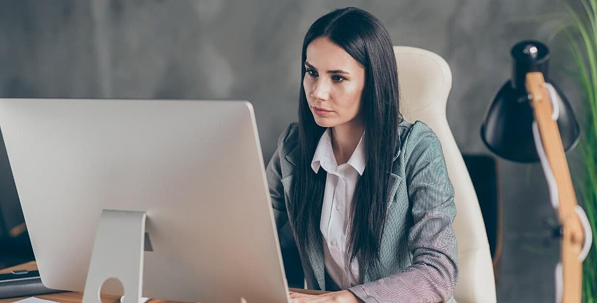 digital marketer reviewing attribution reports on computer