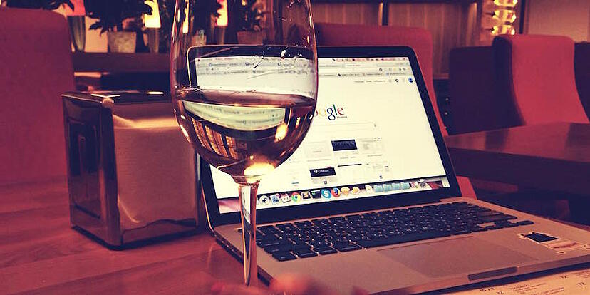 glass-of-wine-and-computer
