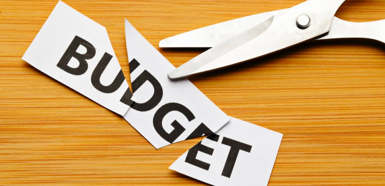 Marketing budget cuts with scissors